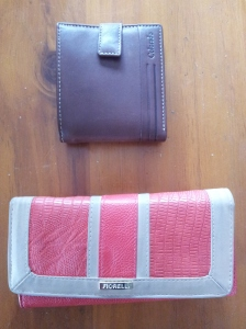 "A ""men's"" wallet (top) and a ""women's"" wallet (bottom). The male version can easily be slipped into a pocket, the female...not so much."