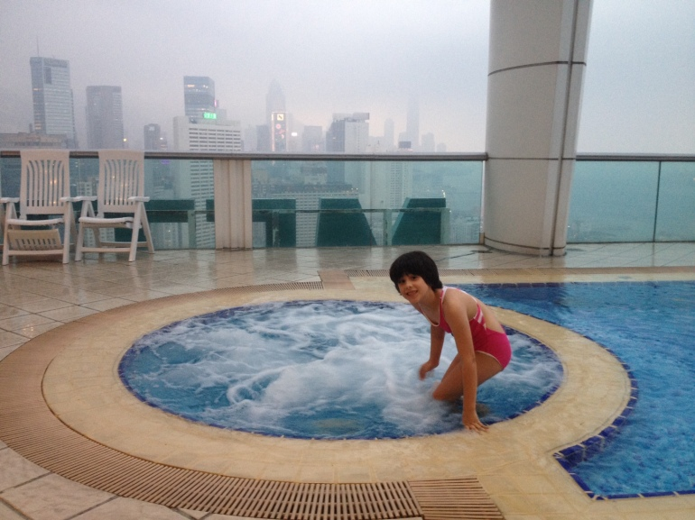 My daughter enjoying the jacuzzi in the rooftop pool in Hong Kong.