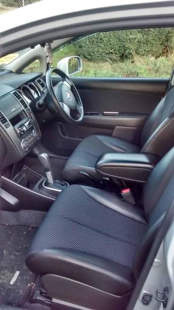Inside my new car. I'm loving the leather trim :)