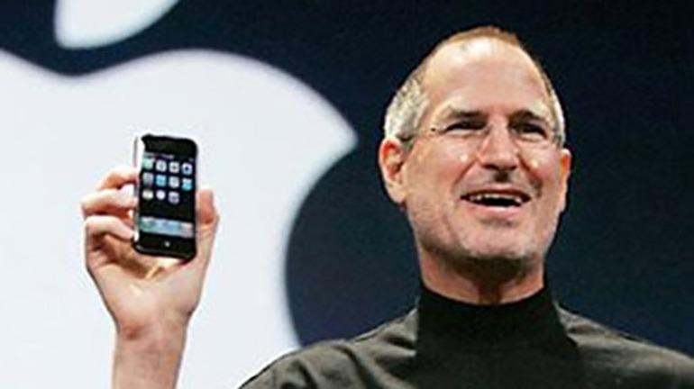 Steve Jobs, of Apple, wearing his personal uniform of a black turtleneck.