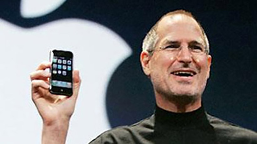 Steve Jobs, of Apple, wearing his personal uniform of a black turtleneck.