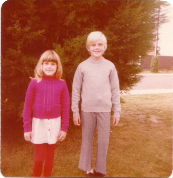 Here I am, with my brother. In this photo the jumper I'm wearing was hand-knitted by mum, and she made the skirt. She also made my brother's trousers, although his jumper may have been bought.
